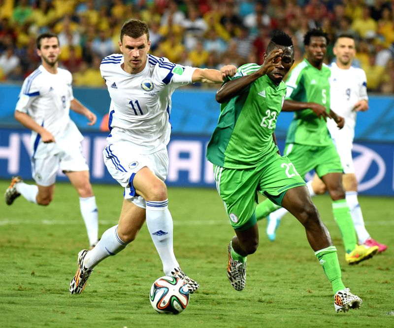 Nigeria's Kenneth Omeruo (R) vies with Bosnia and Herzegovina's Edin Dzeko during a Group F match between Nigeria and Bosnia and Herzegovina of 2014 FIFA World Cup ..