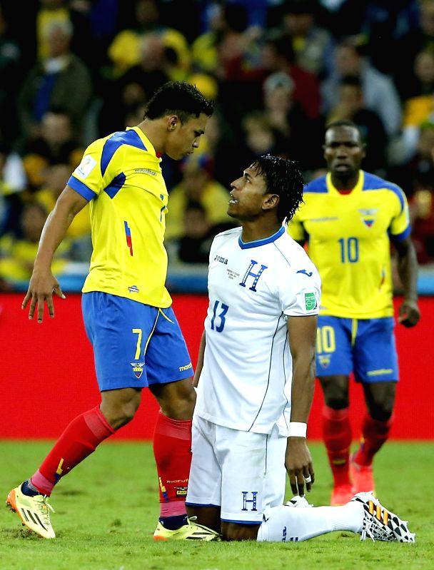 Carlo Costly (R) of Honduras argues with Jefferson Montero of Ecuador during a Group E match between Honduras and Ecuador of 2014 FIFA World Cup at the Arena da ...