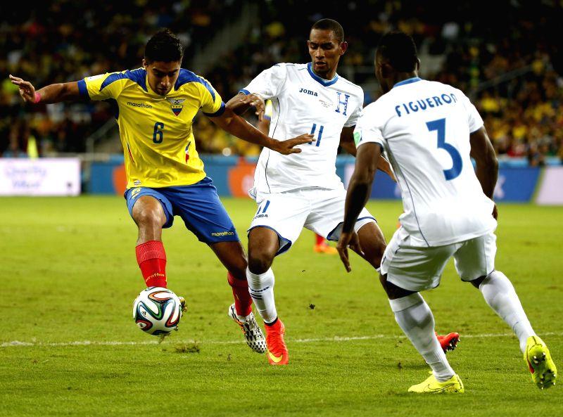 Cristian Noboa (L) of Ecuador with Jerry Bengtson of Honduras during a Group E match between Honduras and Ecuador of 2014 FIFA World Cup at the Arena da Baixada ...