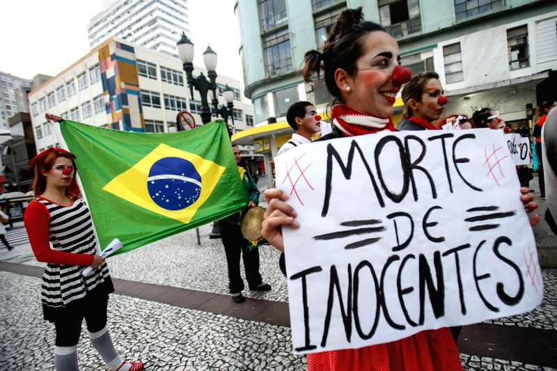 Demonstrators dress as clowns attend a protest against the high organizing cost of the ongoing FIFA World Cup, downtown Curitiba, Brazil, June 20, 2014.