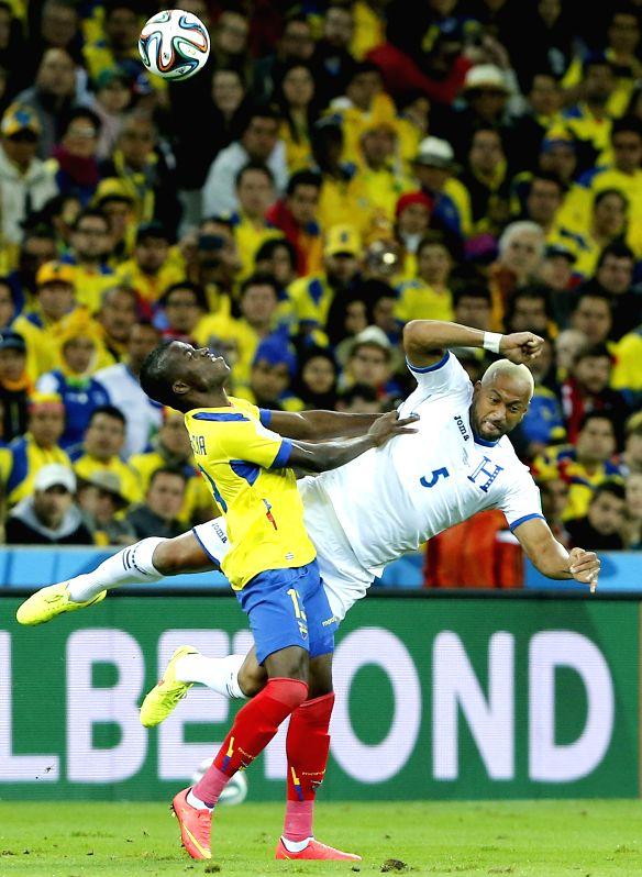 Enner Valencia (L) of Ecuador vies with Victor Bernardez of Honduras during a Group E match between Honduras and Ecuador of 2014 FIFA World Cup at the Arena da ...