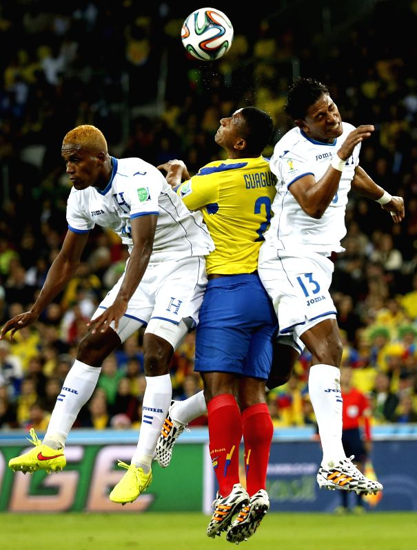 Jorge Guagua (C) of Ecuador fights for the header with Carlo Costly (R) and Brayan Beckeles (L) of Honduras during a Group E match between Honduras and Ecuador of .