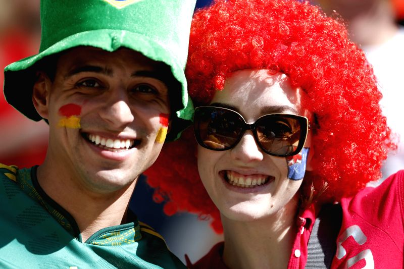 A supporter of Spain (L) poses with a supporter of Australia before a Group B match between Australia and Spain of 2014 FIFA World Cup at the Arena da Baixada ...