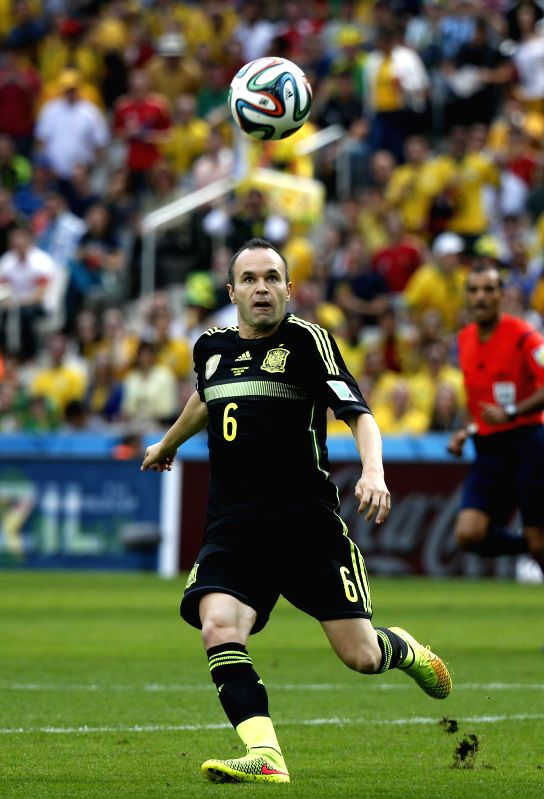 Spain's Andres Iniesta controls the ball during a Group B match between Australia and Spain of 2014 FIFA World Cup at the Arena da Baixada Stadium in Curitiba, ...