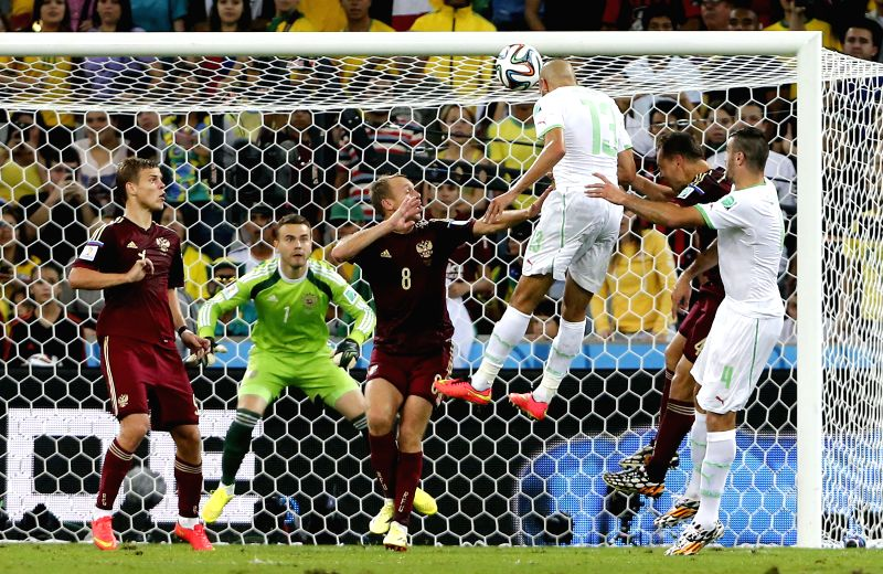 Algeria's Islam Slimani (3rd R) shoots a header during a Group H match between Algeria and Russia of 2014 FIFA World Cup at the Arena da Baixada Stadium in ...