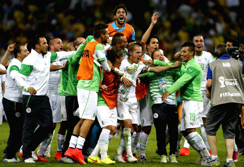 Algeria's players celebrate after a Group H match between Algeria and Russia of 2014 FIFA World Cup at the Arena da Baixada Stadium in Curitiba, Brazil, June 26, ..