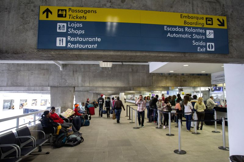 People wait in line to buy bus tickets at Curitiba Coach Station, in Curitiba, Brazil, on May 11, 2014. The station is part of the transport works for FIFA's Soccer