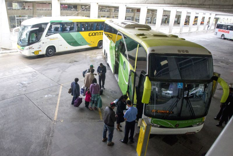 People wait to board a bus at Curitiba Coach Station in Curitiba, Brazil, on May 11, 2014. The station is part of the transport works for FIFA's Soccer World Cup, ..