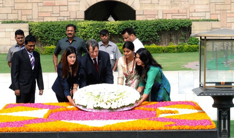 Cyprus President Nicos Anastasiades lays wreath at the Samadhi of Mahatma Gandhi, at Rajghat in Delhi on April 28, 2017. Also seen Minister of State for Health & Family Welfare ... - Welfare Anupriya Patel
