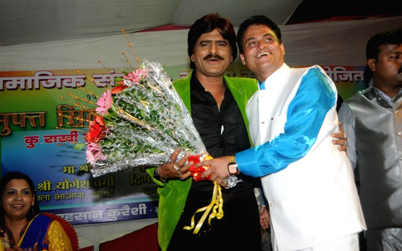 Cyril D`Souza felicitating Ehsaan Qureshi during a celebration on Women Empowerment initiative by `Awaz Samajik Sanstha`of Cyril D`Souza in Mumbai, on Aug. 17, 2014.