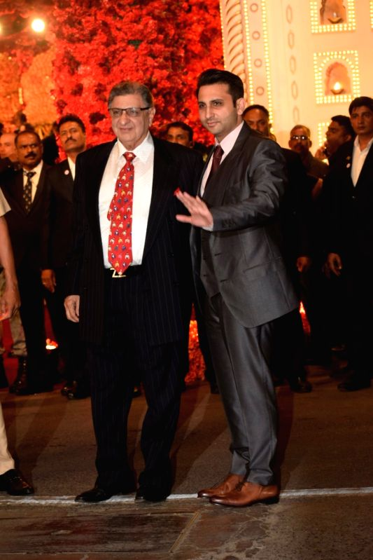 Cyrus S. Poonawalla and his son Adar Poonawallaat the wedding ceremony of industrialist Mukesh Ambani's daughter Isha Ambani and Anand Piramal at Antilia in Mumbai on Dec 12, 2018. - Mukesh Ambani and Isha Ambani