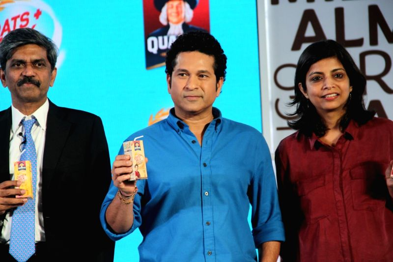 D Shivakumar, Chairman, PepsiCo India, former Indian cricket player Sachin Tendulkar and Deepika Warrier, VP, Nutrition Category, PepsiCo India, during the launch of Quaker Oats+Milk, in ... - Sachin Tendulkar