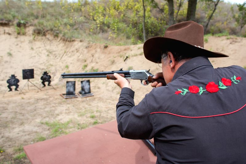 A competitor shoots with a rifle during the 10th Hungarian Cowboy Action Shooting National Championship in Dabas, about 50 km southeast from capital city Budapest, ...