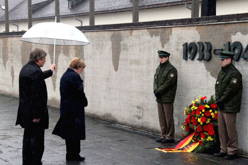 German Chancellor Angela Merkel (2nd L) lays a wreath during a ceremony at the memorial in the Dachau Concentration Camp in Dachau, Germany, on May 3, 2015. German ...