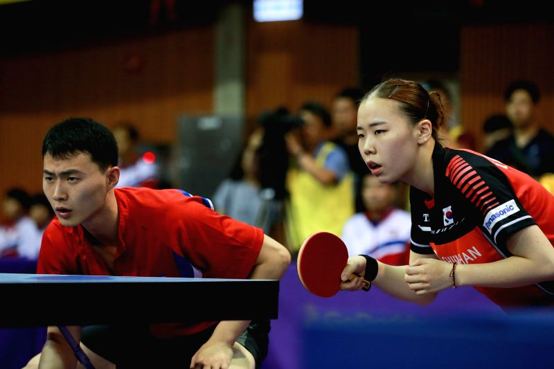 DAEJEON, July 17, 2018 - Yoo Eunchong (R) of South Korea and Choe Il of the Democratic People's Republic of Korea (DPRK) compete during the Mixed Doubles match at 2018 ITTF World Tour Korea Open ...