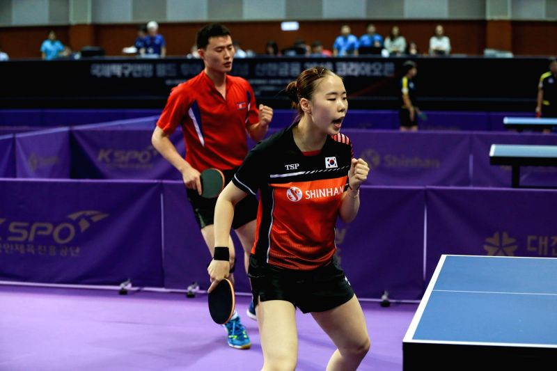 DAEJEON, July 17, 2018 - Yoo Eunchong (R) of South Korea and Choe Il of the Democratic People's Republic of Korea (DPRK) celebrate scoring during the Mixed Doubles match of 2018 ITTF World Tour Korea ...