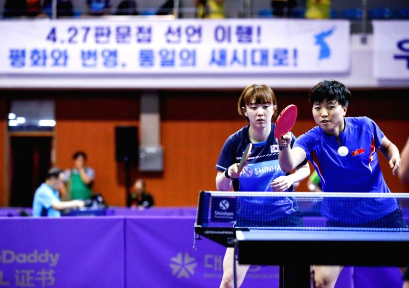 DAEJEON, July 18, 2018 - Suh Hyowon (L) of South Korea and Kim Song I of the Democratic People's Republic of Korea (DPRK) compete during the women's doubles preliminary round 1 match against Kim Olga ...