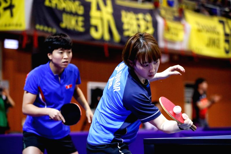 DAEJEON, July 18, 2018 - Suh Hyowon (R) of South Korea and Kim Song I of the Democratic People's Republic of Korea (DPRK) compete during the women's doubles preliminary round 1 match against Kim Olga ...