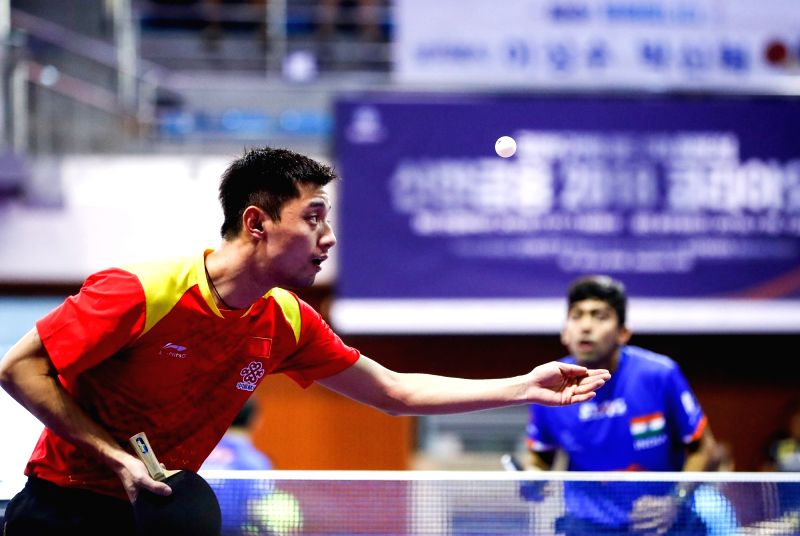 DAEJEON, July 18, 2018 - Zhang Jike (L) of China serves during the men's singles group match against harmeet Desai of India at 2018 ITTF World Tour Korea Open in Daejeon, South Korea, July 18, 2018.