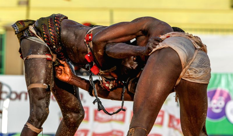 """Wrestlers compete in the Senegalese traditional wrestling match """"Le Choc"""" at Demba Diop Stadium, Dakar, capital of Senegal, April 5, 2015. Thousands of ..."""