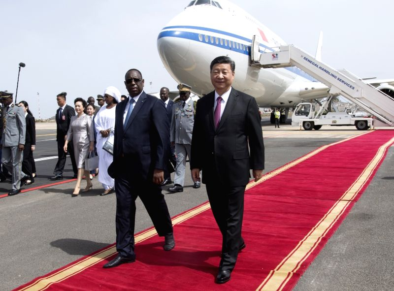 DAKAR, July 21, 2018 - Chinese President Xi Jinping attends a grand welcome ceremony held by Senegalese President Macky Sall at the airport in Dakar, Senegal, July 21, 2018. Xi arrived here Saturday ...