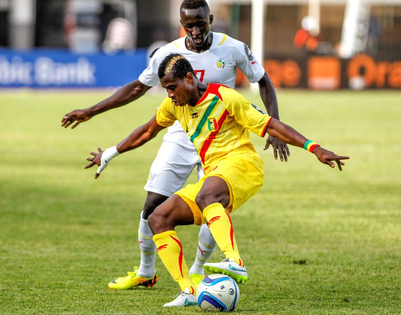 Youssouf Kone (Front) of Mali controls the ball during the semifinal of the 2015 African U20 Championship against Senegal in Dakar, Senegal, March 19, 2015. Senegal ...