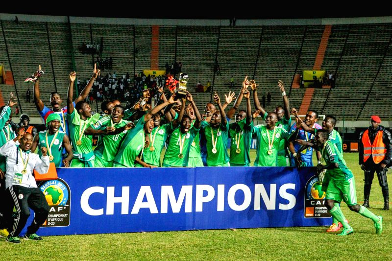 Nigerian football players pose for a photo after defeating Senegal in the final of the 2015 African U20 Championship in Dakar, March 22, 2015. Nigeria claims the ...