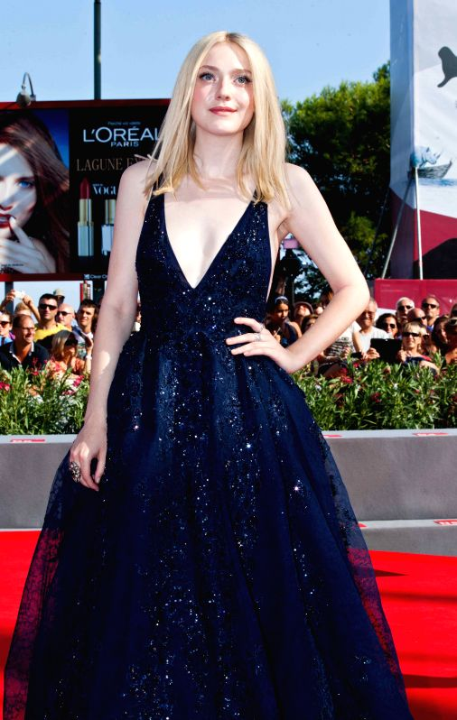 ": Dakota Fanning, actress of the movie ""Night Moves"" poses at red carpet during the 70th Venice International Film Festival in the Lido of Venice , Italy, Aug. 31, ..."