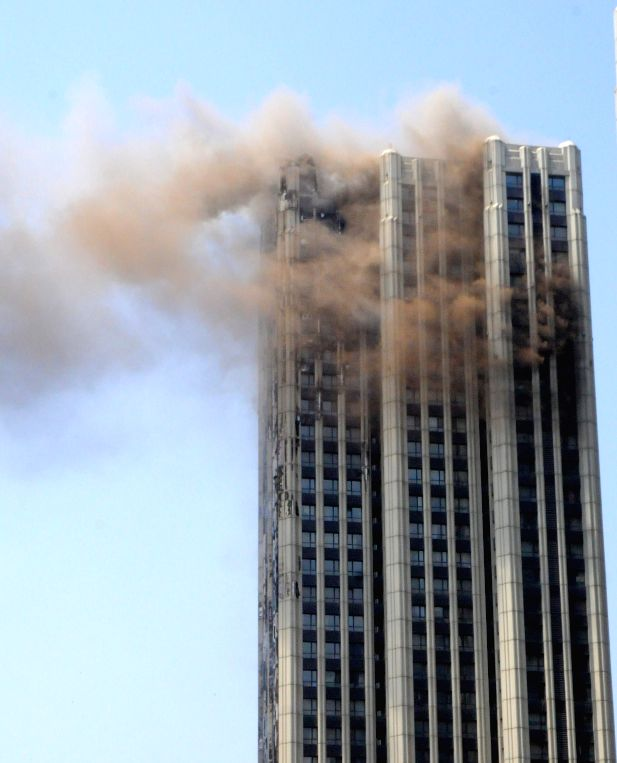 Insulating layers of a high-rise residential building is on fire at Xinghai Square in Dalian, northeast China's Liaoning Province, April 21, 2014. The fire, which ..