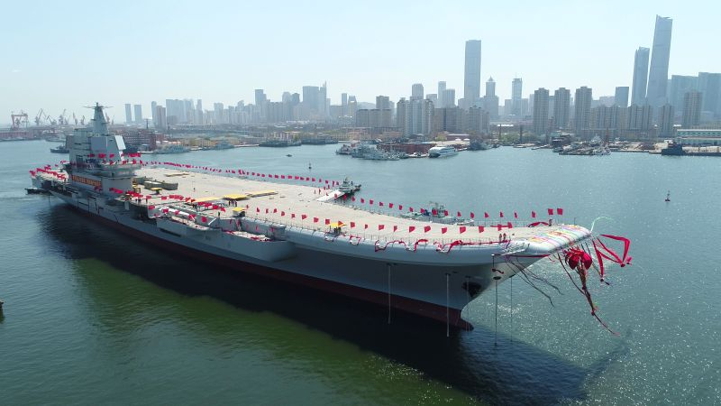 DALIAN, April 26, 2017 - China's second aircraft carrier is transferred from dry dock into the water at a launch ceremony in Dalian shipyard of the China Shipbuilding Industry Corp. in Dalian, ...