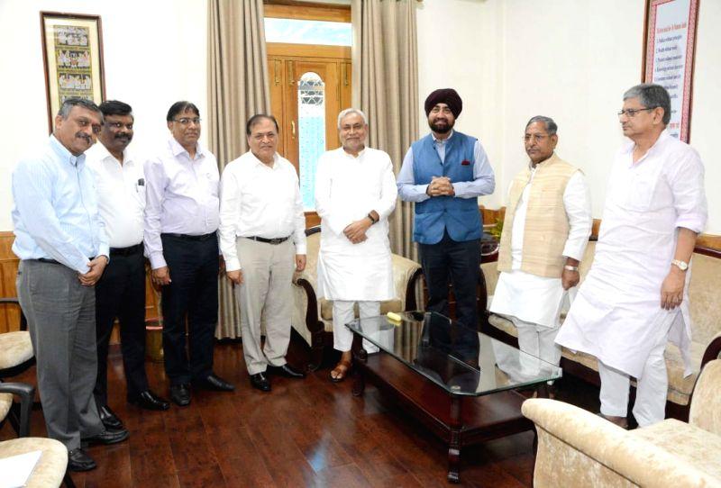 Dalmia Bharat group CEO Mahendra Singhi calls on Bihar Chief Minister Nitish Kumar, in Patna on July 17, 2018. - Nitish Kumar