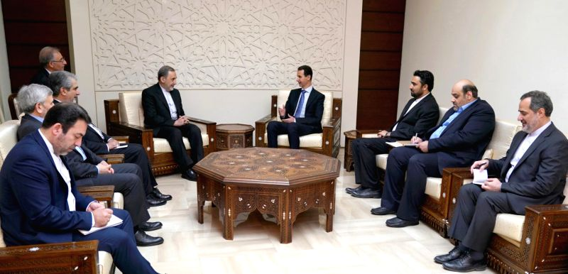 DAMASCUS, April 13, 2018 - Syrian President Bashar al-Assad (4th, R) speaks with Ali Akbar Velayati (5th, R), a senior advisor to Iran's Supreme er Ayatollah Ali Khamenei, in Damascus, capital of ...