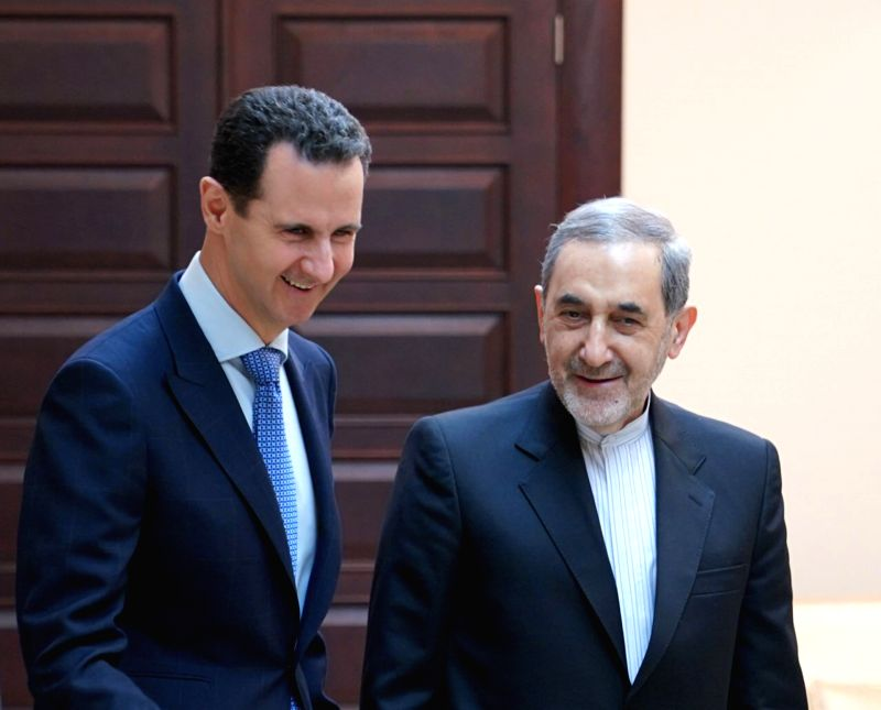 DAMASCUS, April 13, 2018 - Syrian President Bashar al-Assad (L) speaks with Ali Akbar Velayati, a senior advisor to Iran's Supreme er Ayatollah Ali Khamenei, in Damascus, capital of Syria, on ...