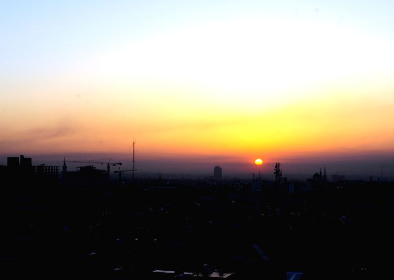 DAMASCUS, April 14, 2018 - Sunrise is seen in the Syrian capital Damascus on April 14, 2018. The U.S. started military actions against Damascus before daybreak Saturday as loud explosions were heard ...