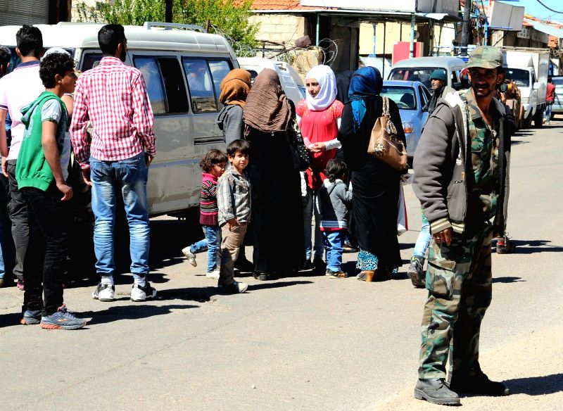 DAMASCUS, April 19, 2017 - Residents enter the town of Zabadani, western countryside of Damascus, capital of Syria, following the evacuation of the last rebel group from their town, on April 19, ...