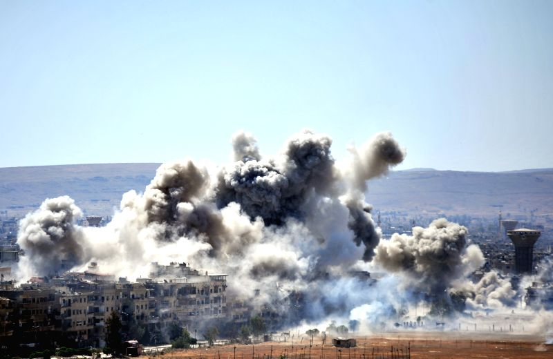 DAMASCUS, April 24, 2018 - Photo taken on April 24, 2018 shows smoke rising from the Islamic State militant's positions in the Hajar al-Aswad neighbourhood, south of Damascus, Syria. The Syrian army ...