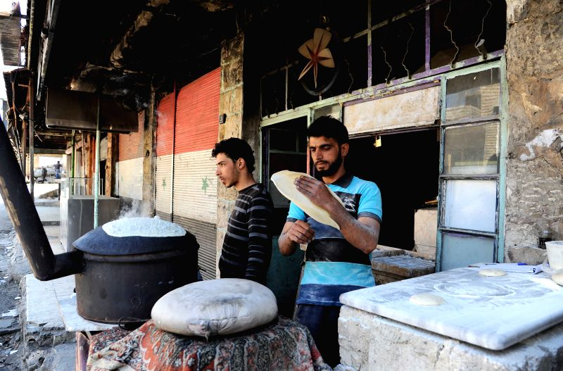 DAMASCUS, April 25, 2017 - Syrian bakers make bread at their bakery store in the mountainous town of Madaya, in the western countryside of Damascus, capital of Syria, on April 25, 2017. The towns of ...