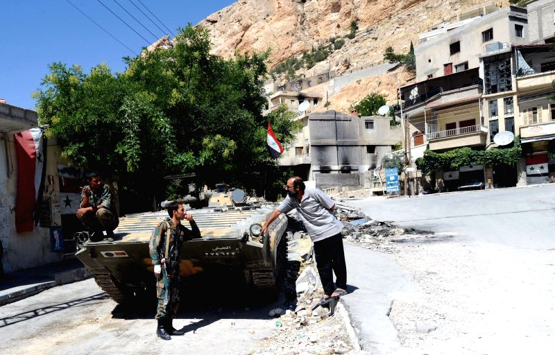 A soldier patrols in the historic Christian town of Maaloula, north of Damascus, capital of Syria, Aug. 21, 2014. Maaloula is one of the oldest cradles of ...