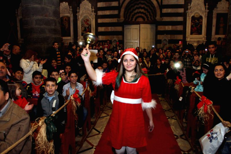 People watch the performance during the Christmas celebration at al-Zaitoun Cathedral in Damascus, capital of Syria, on Dec. 30, 2014. About 1,500 Syrian Christian