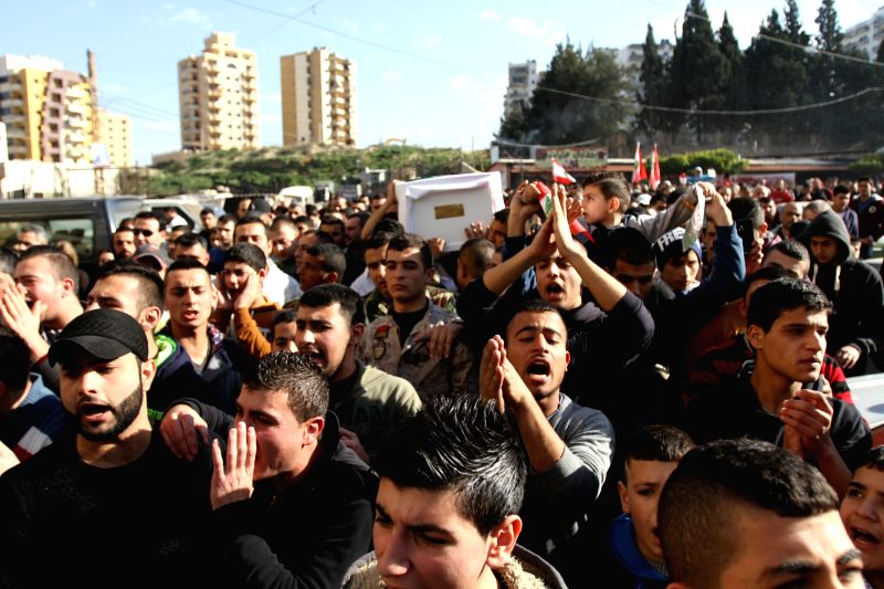 People take part in the funeral procession of an officer and four soldiers in Damascus, Lebanon, on Jan. 24, 2015. The Lebanese army said on Friday that an ...