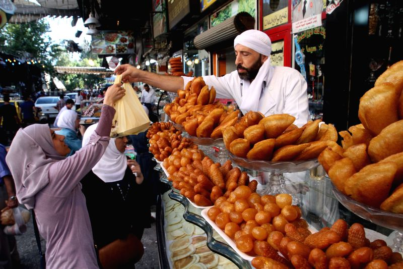 Good Dessert Eid Al-Fitr Food - damascus-july-25-2014-xinhua-a-syrian-man-sells-204545  Pictures_367118 .jpg