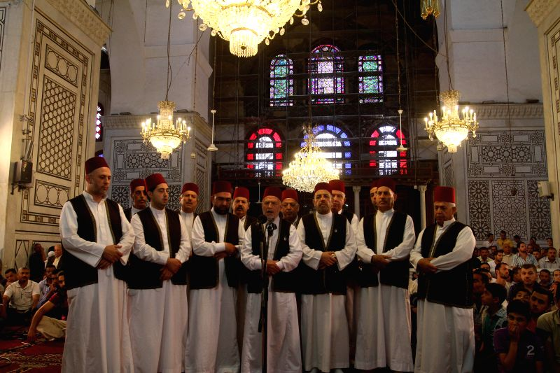 Syrians pray at Umayyad Mosque in the old city of Damascus, Syria on Friday, July 25, 2014, the last Friday of the Muslims holy month of Ramadan during which ...