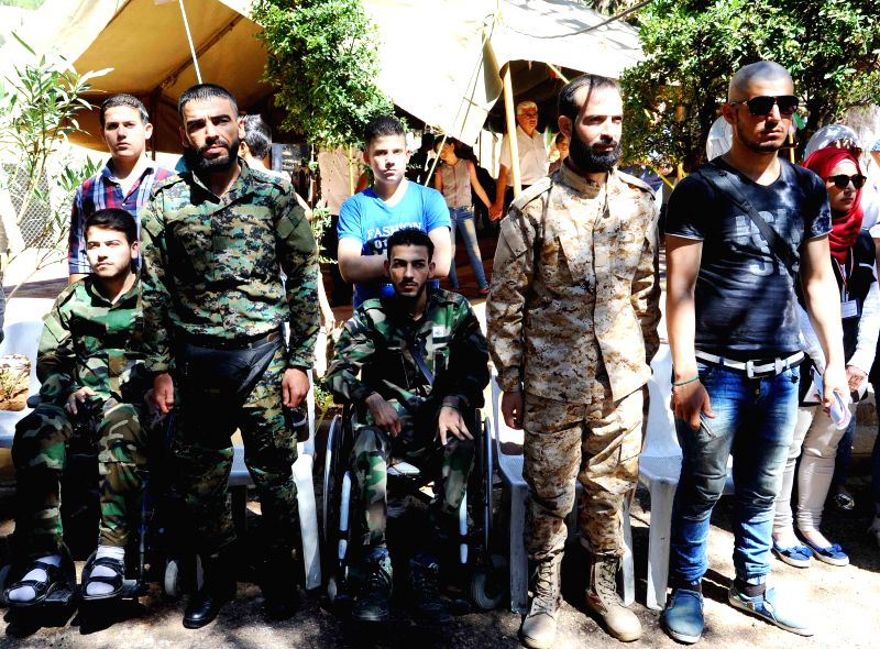 DAMASCUS, July 25, 2016 - Wounded Syrian soldiers participate in honoring ceremony held in Damascus, Syria, on July 24, 2016. (Xinhua/Ammar)