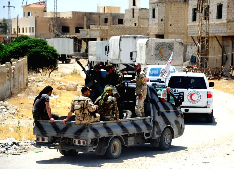 DAMASCUS, June 2, 2016 - A convoy of relief aid enters the besieged rebel-held city of Daraya near Damascus, capital of Syria, on June 1, 2016. Relief aid entered the besieged city of Daraya near the ...