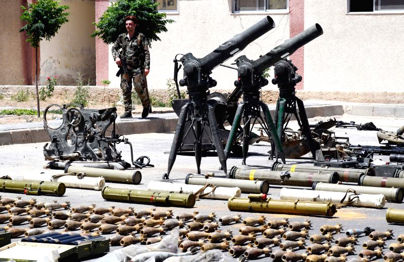 DAMASCUS, June 3, 2019 (Xinhua) -- Photo taken on June 3, 2019 shows confiscated weapons at a security base in Damascus, Syria. The Syrian army found these weapons through combing and inspecting formerly rebel-held areas in the southern region. (Xinh