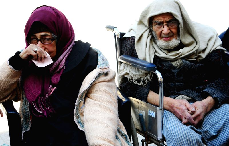 DAMASCUS, March 13, 2018 - An evacuated couple sit in a temporary shelter in Wafidin area, northeast of Damascus, capital of Syria, on March 13, 2018. A total of 146 civilians on Tuesday left the ...
