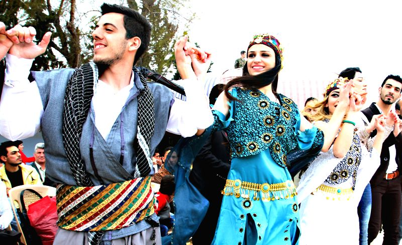 Syrian Kurds dance as they gather to celebrate the Nowruz festival in Damascus, capital of Syria, on March 21, 2015. Kurds in Syria, Iran, Turkey, Lebanon and ...