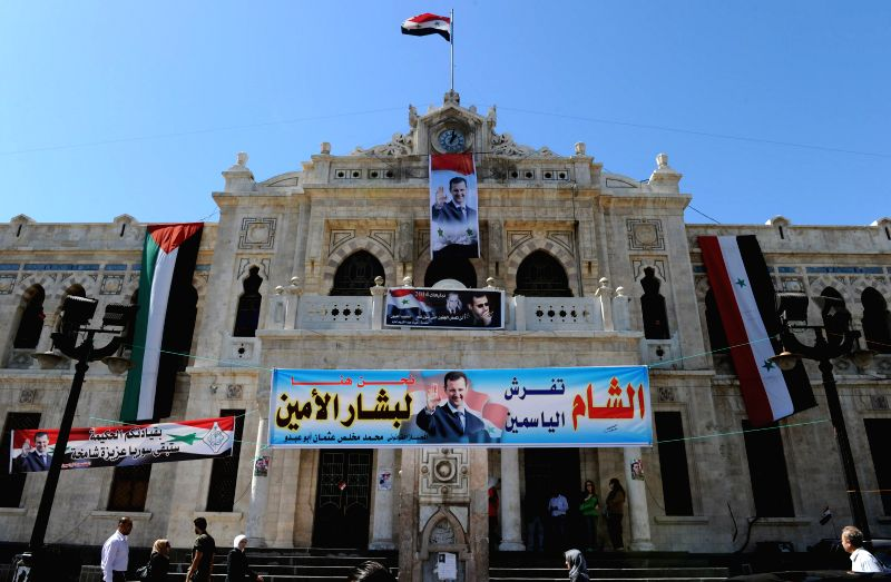 Photo: Photo: Photo: Election campaign posters of incumbent President Bashar al-Assad are seen at a railway station in Damascus, capital of Syria, May 13, 2014. ...