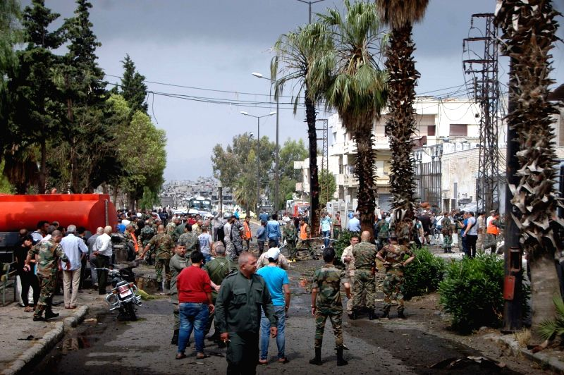 DAMASCUS, May 23, 2017 - People gather at the al-Zahra'a neighborhood in Syria's central city of Homs following the blast on May 23, 2017. A car bomb went off in Syria's central city of Homs on ...