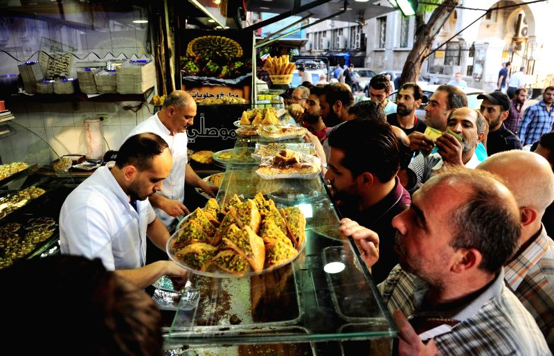 DAMASCUS, May 28, 2017 - Syrians buy food on the occasion of the holy month of Ramadan in the Bab Srijeh marketplace in Damascus, capital of Syria, on May 28, 2017. Muslims around the world celebrate ...